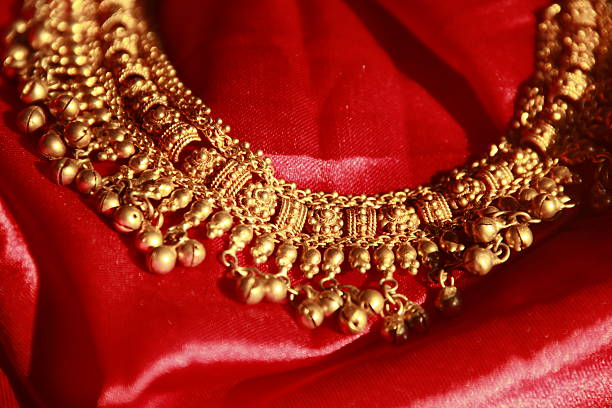 gold necklace with bells